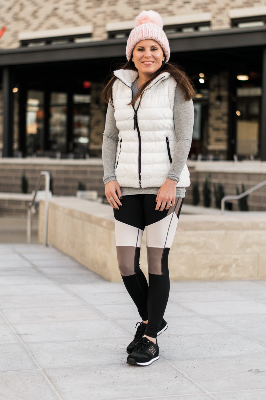 Calvin Klein Performance Sherpa Vest, New Balance Sneakers, Free People Happy Trails Pom Beanie, Trouve Layering Tee